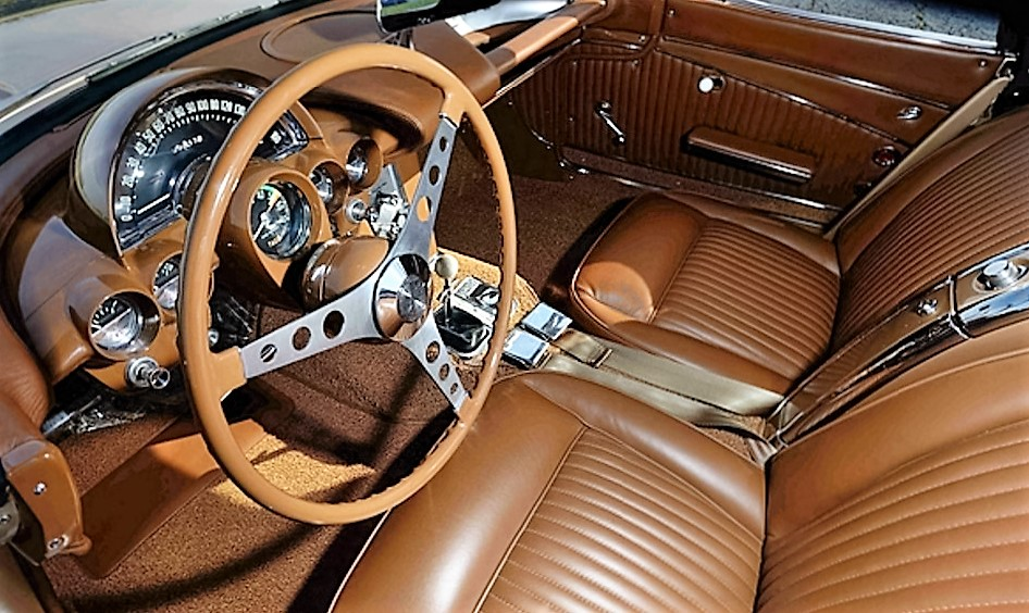 The upholstery was done in the original tan leather | Mecum