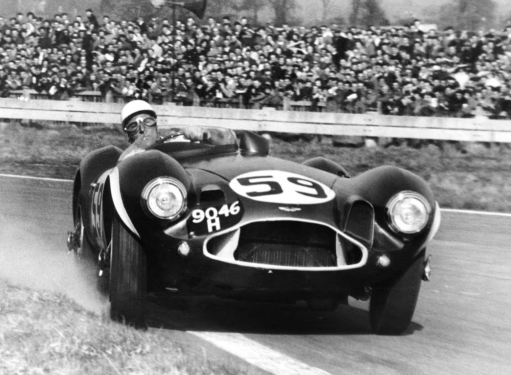 The legendary Stirling Moss rounds a curve in the Aston Martin DB3S | Bonhams archive