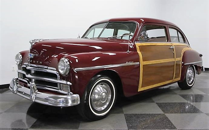 The custom wood trim on the 1950 Plymouth coupe looks good enough to be original