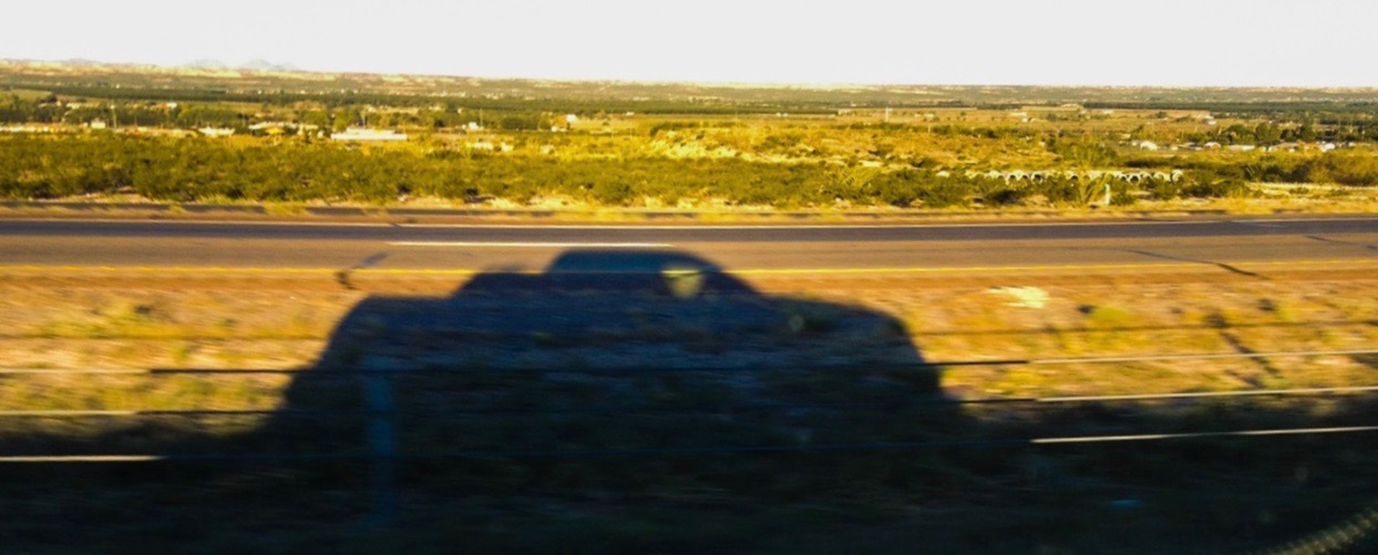 On the road again: My pickup truck casts a shadow as we cross the prairie | Larry Edsall photos