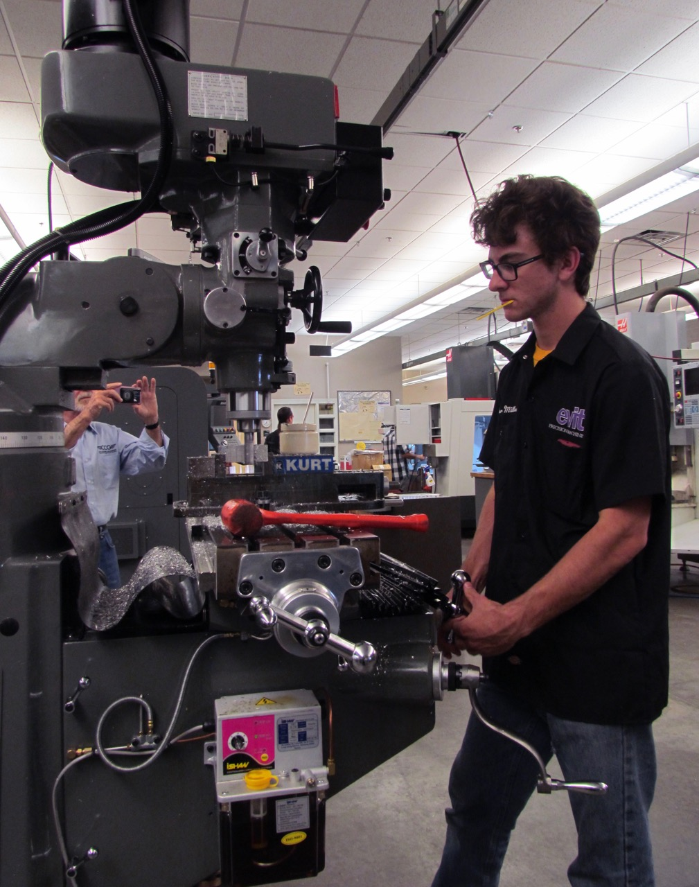 An EVIT student at work in the automotive workshop