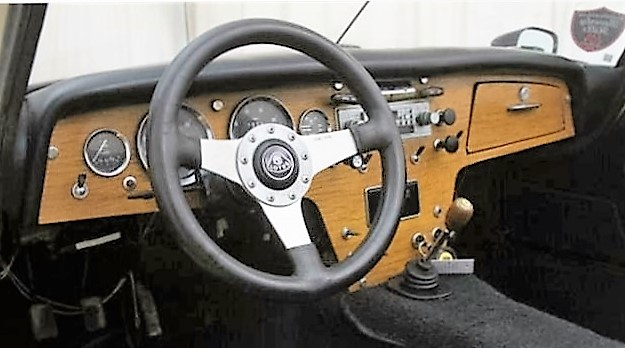 The interior features a classic wood dashboard.