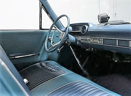 The simple interior with its tall shifter and tach looks purposeful