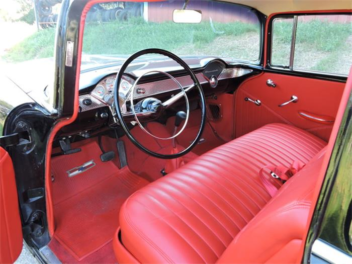 The bright-red bench-seat interior is as original