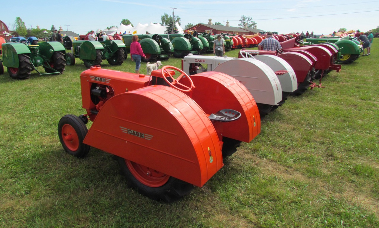 Fenders designed to protect low-hanging branches and fruit make orchard tractors look like they're reading for racing | Larry Edsall photos
