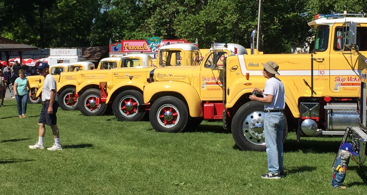 Skip Mckean's display of matching Mack trucks, but in increasing size | Jed Rapoport photos