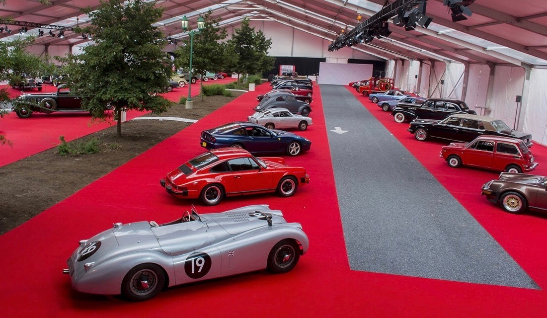 Tent showcases cars before the sale