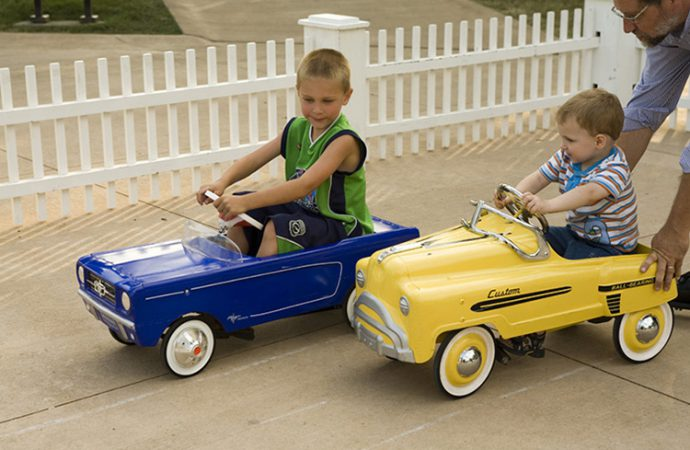 Hoods up, ride-alongs for 'car-guy' dads at museums