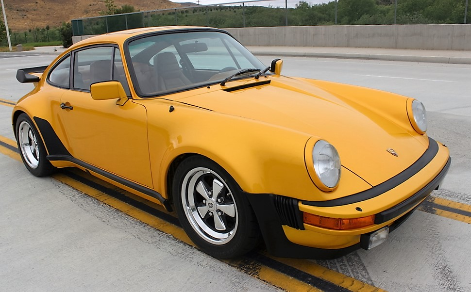 The 1979 Porsche 911 Turbo coupe is unique in the factory 'paint sample' color of Pearl Yellow Gold | Russo and Steele photos