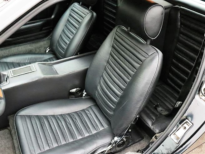 The seat were recently recovered with new black leather