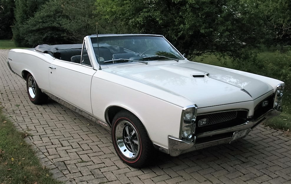The 1967 Pontiac GTO is painted a brilliant white