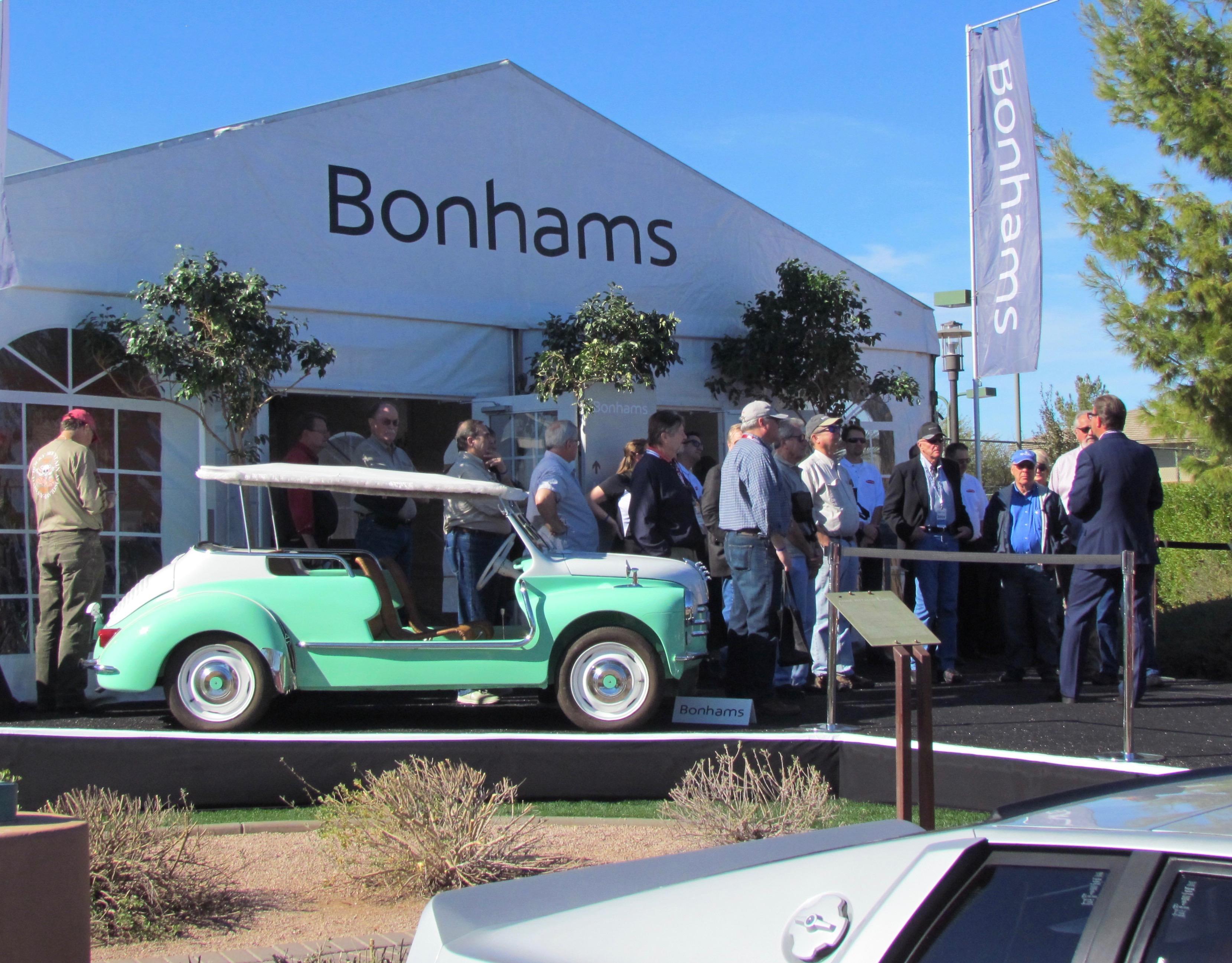 Andy Reid (right) meets a tour group outside the Bonhams tent | Classic Car News photo