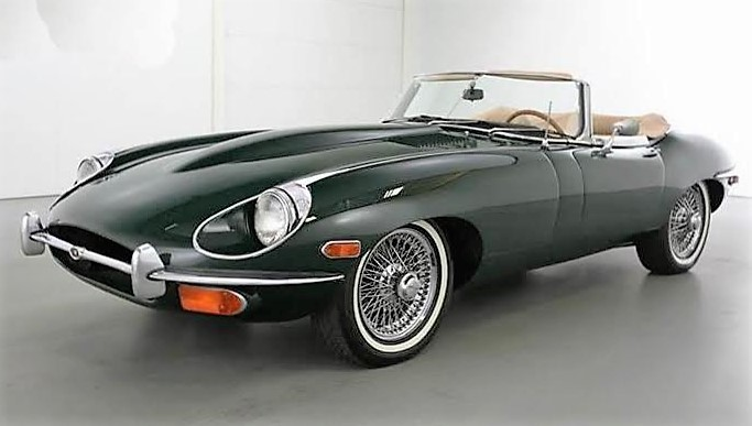 The Jaguar E-Type is described as a well-maintained car with a repaint and restored interior