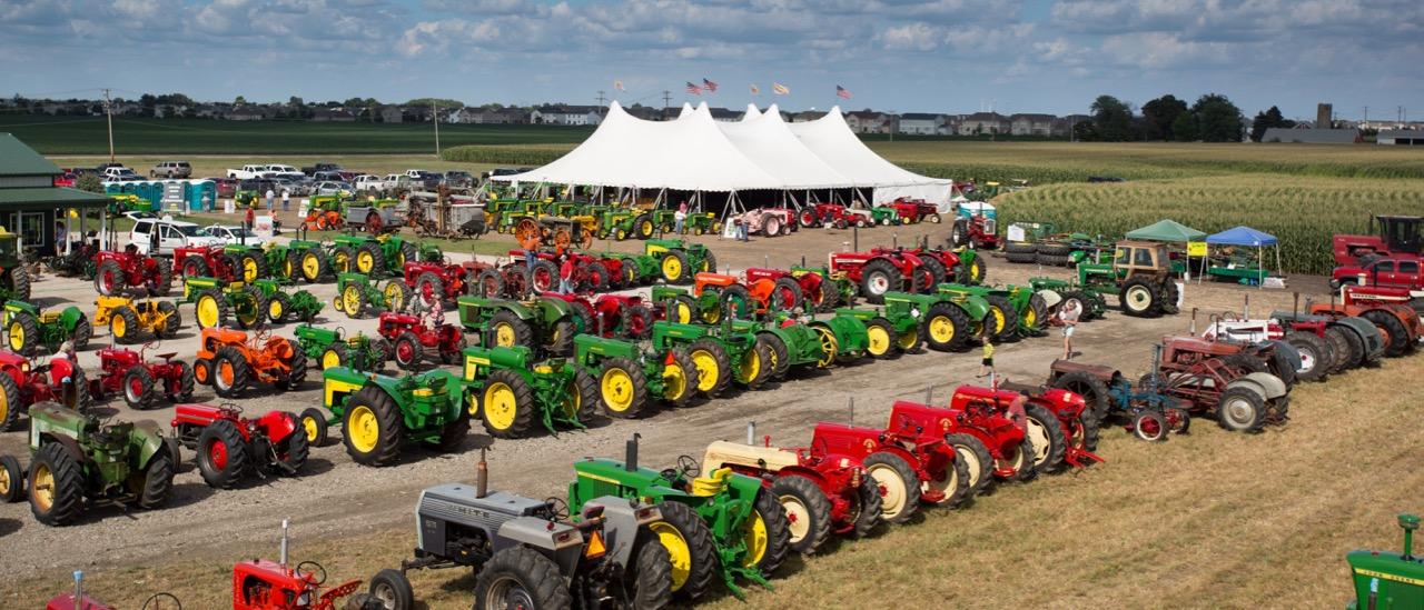 Vintage tractors ready for sale at Summer Showcase sale by Mecum's Gone Farmin'   Mecum Auctions photos