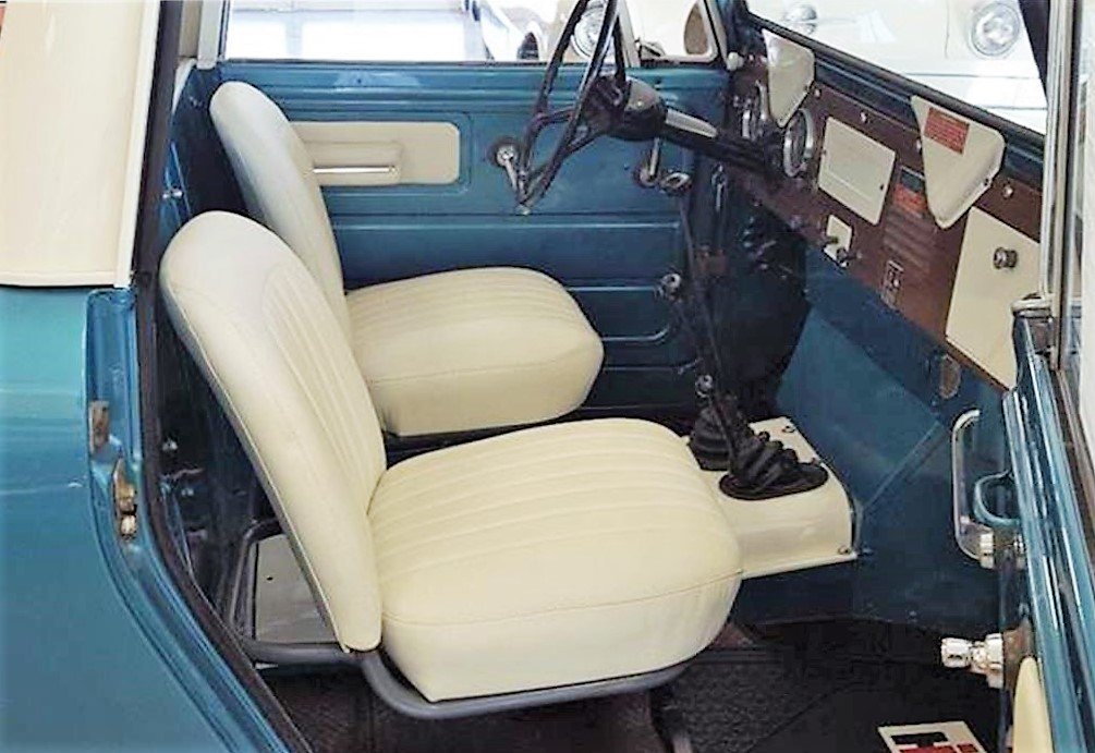 The seats have been reupholstered with white leather