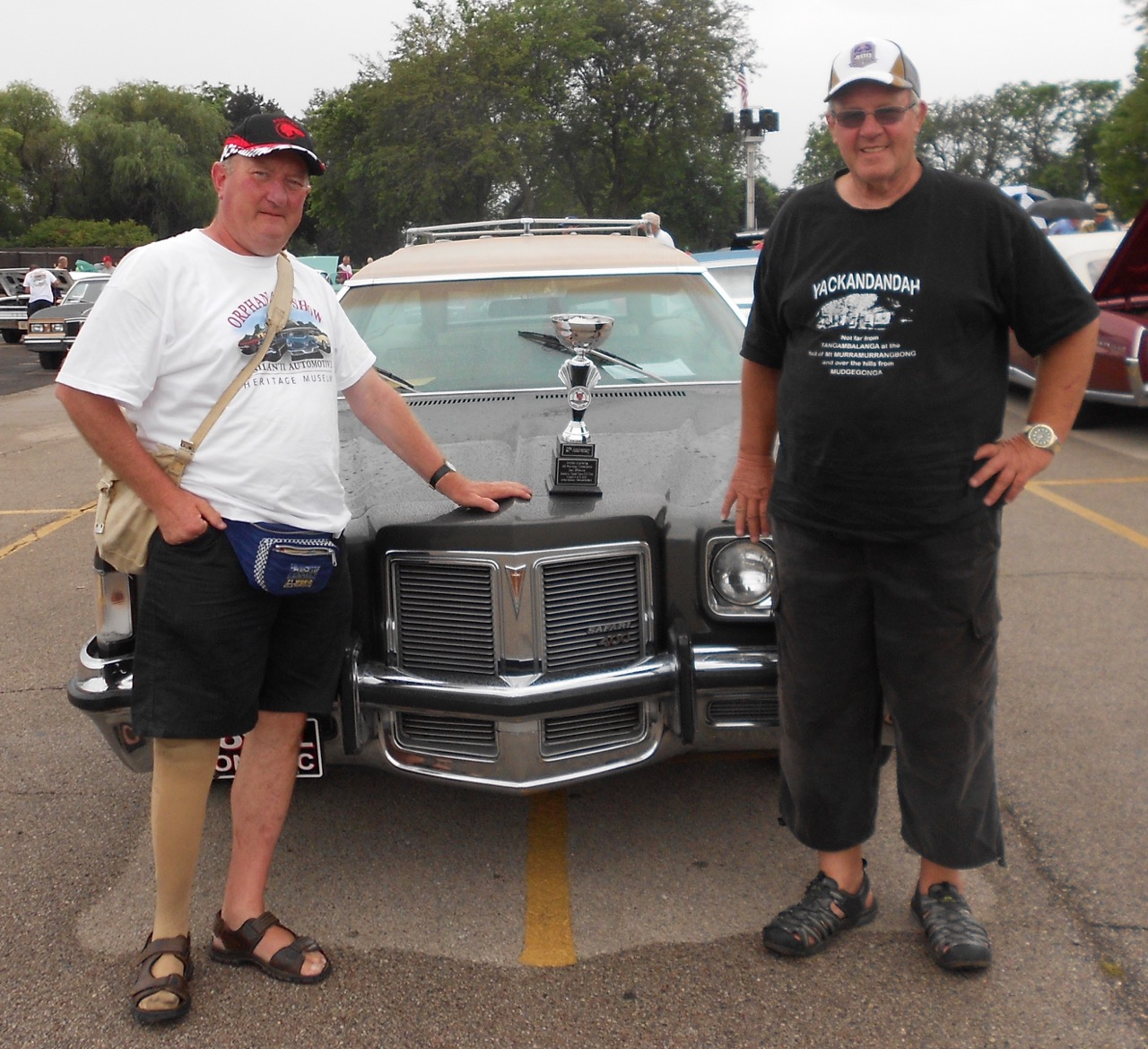 Malcolm (left) and Pete and their Pontiac and its trophy