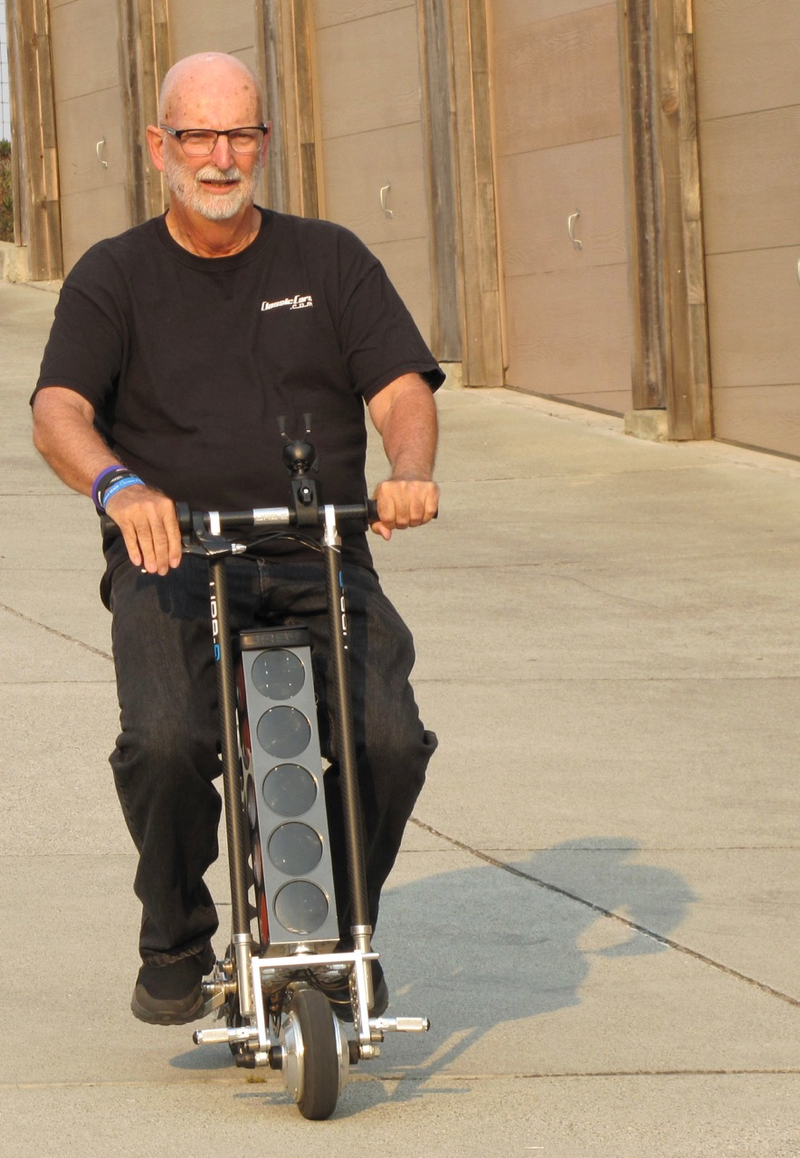 Larry rides the URB-E electric scooter | Bob Golfen photo