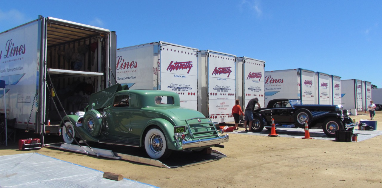 Haulers load and unload for Monterey Car Week