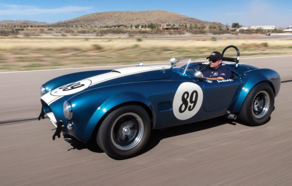 Jim Click at the wheel of the Cobra | RM Sotheby's