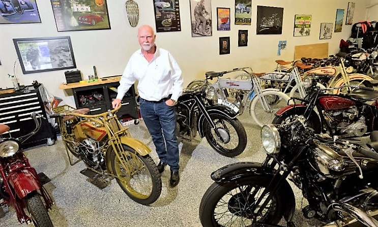 Dr. J. Craig Venter with some of the vintage motorcycles in his collection | Mecum Auctions photos