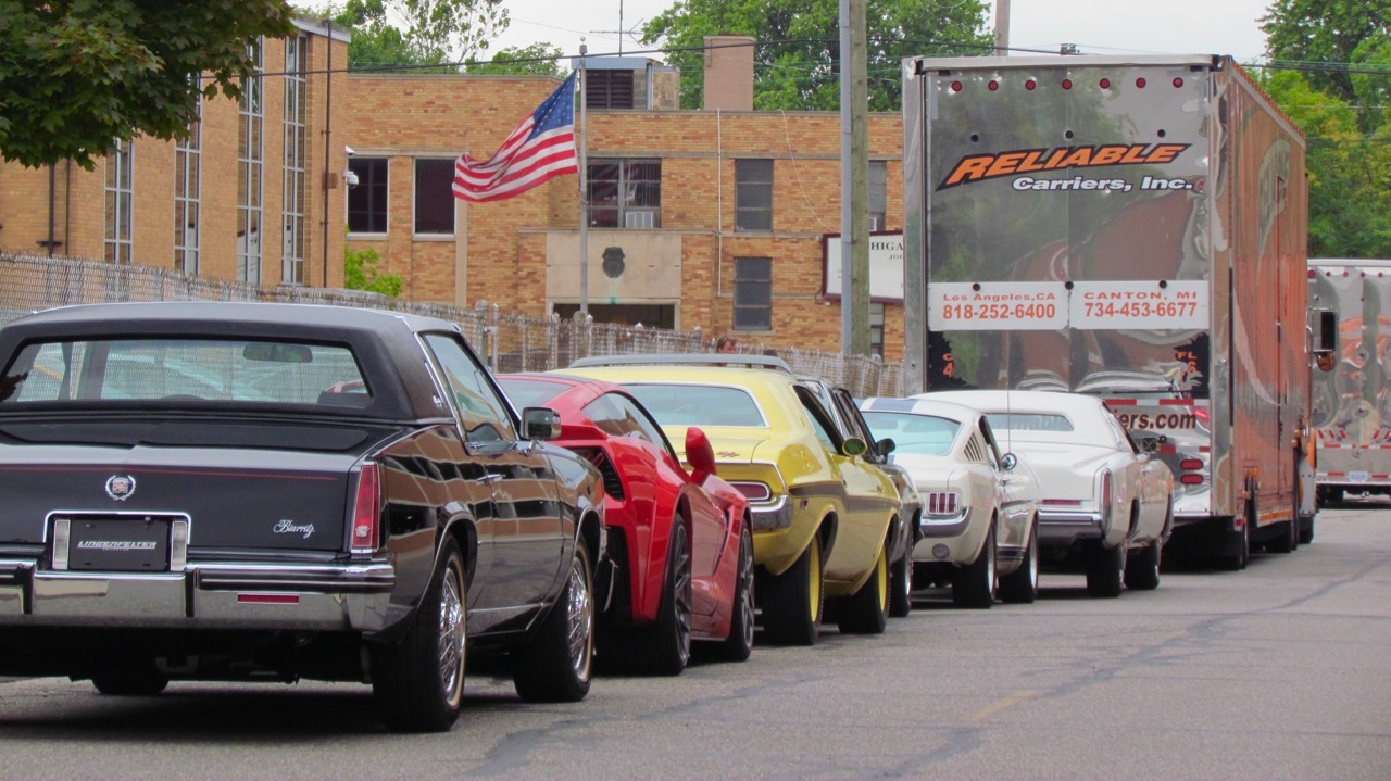 Cars off the transport truck but waiting to be processed onto the Leake Motor City docket | Larry Edsall photos