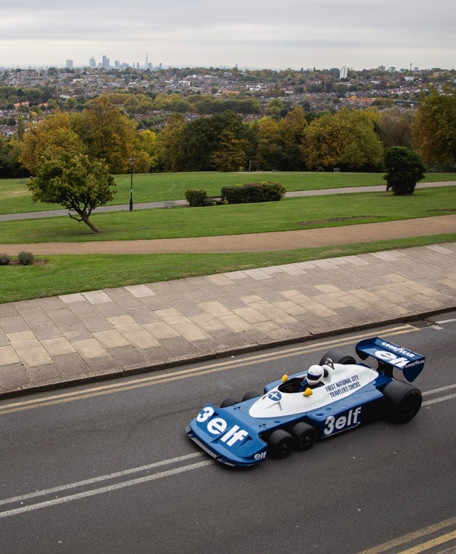 1977 Tyrrell six-wheel F1 racer on road with London skyline