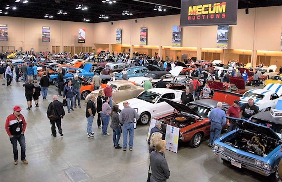 The crowd mills around the vehicles offered at Mecum's Chicago auction | Mecum Auctions