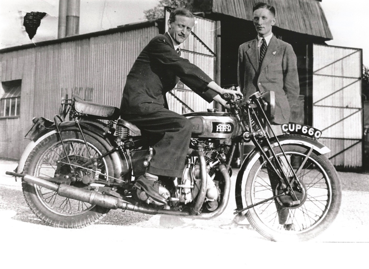 Philip Vincent on the 1938 Rapide, with Ray Pett standing | H&H Classics photos