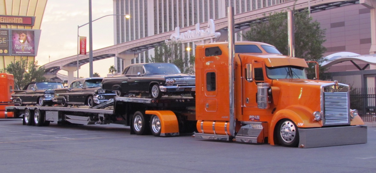 A trio of black classic Chevys on the transporter | Larry Edsall photos