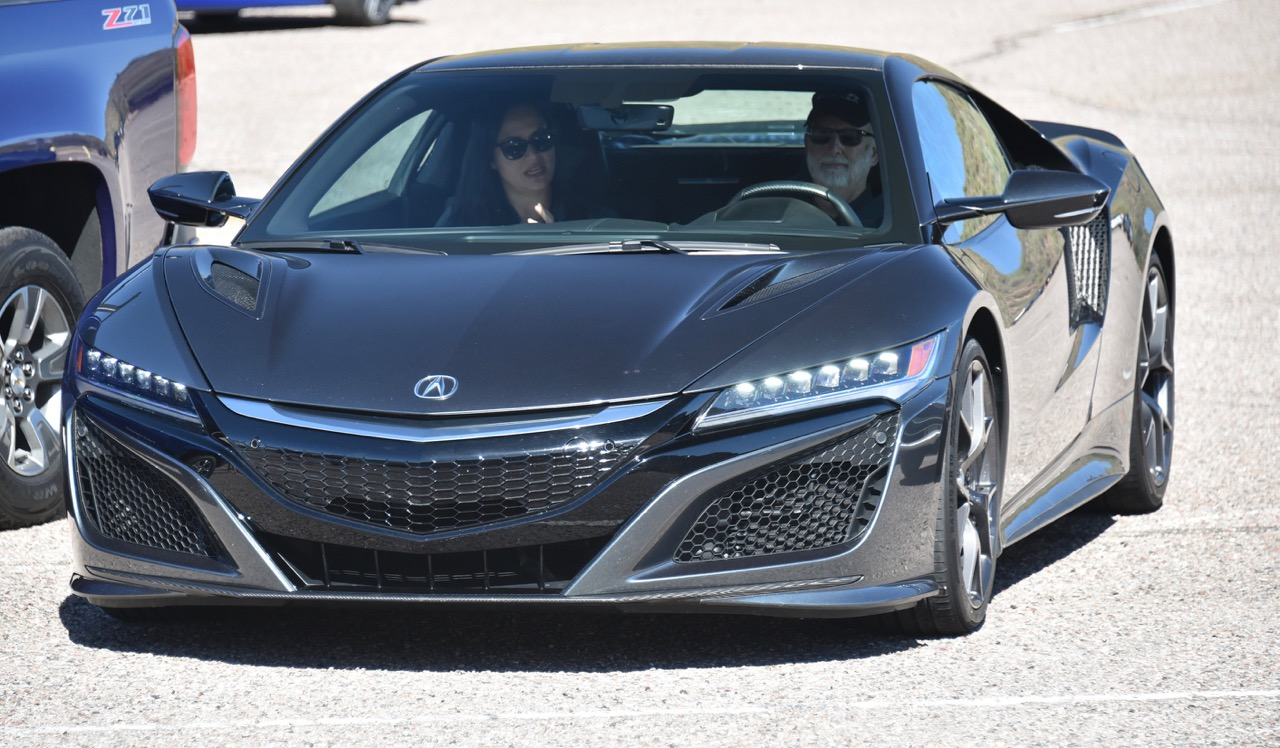 Larry leaves the parking lot at the wheel of the NSX