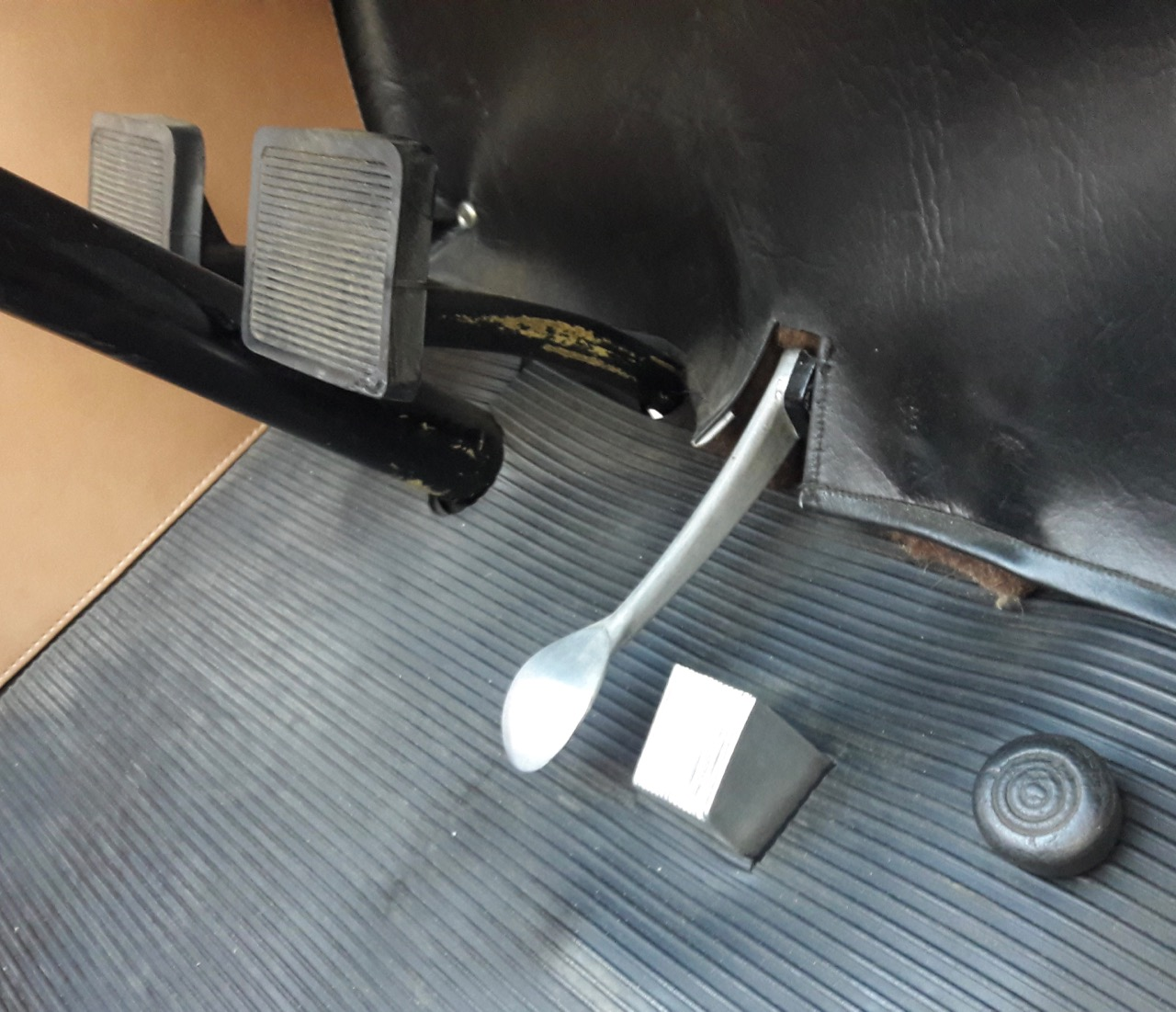 Clutch and brake pedals are separated by steering column
