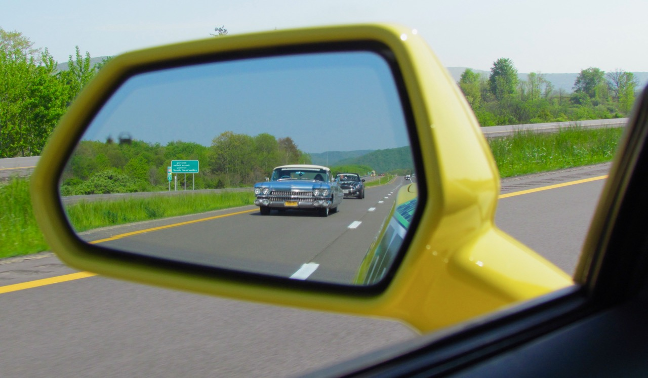 '59 Caddy convertible in rearview mirror of 2017 Camaro convertible on ELK Charity Challenge