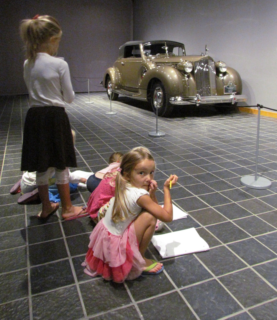 Home-schooled students sketch classic cars at Notre Dame
