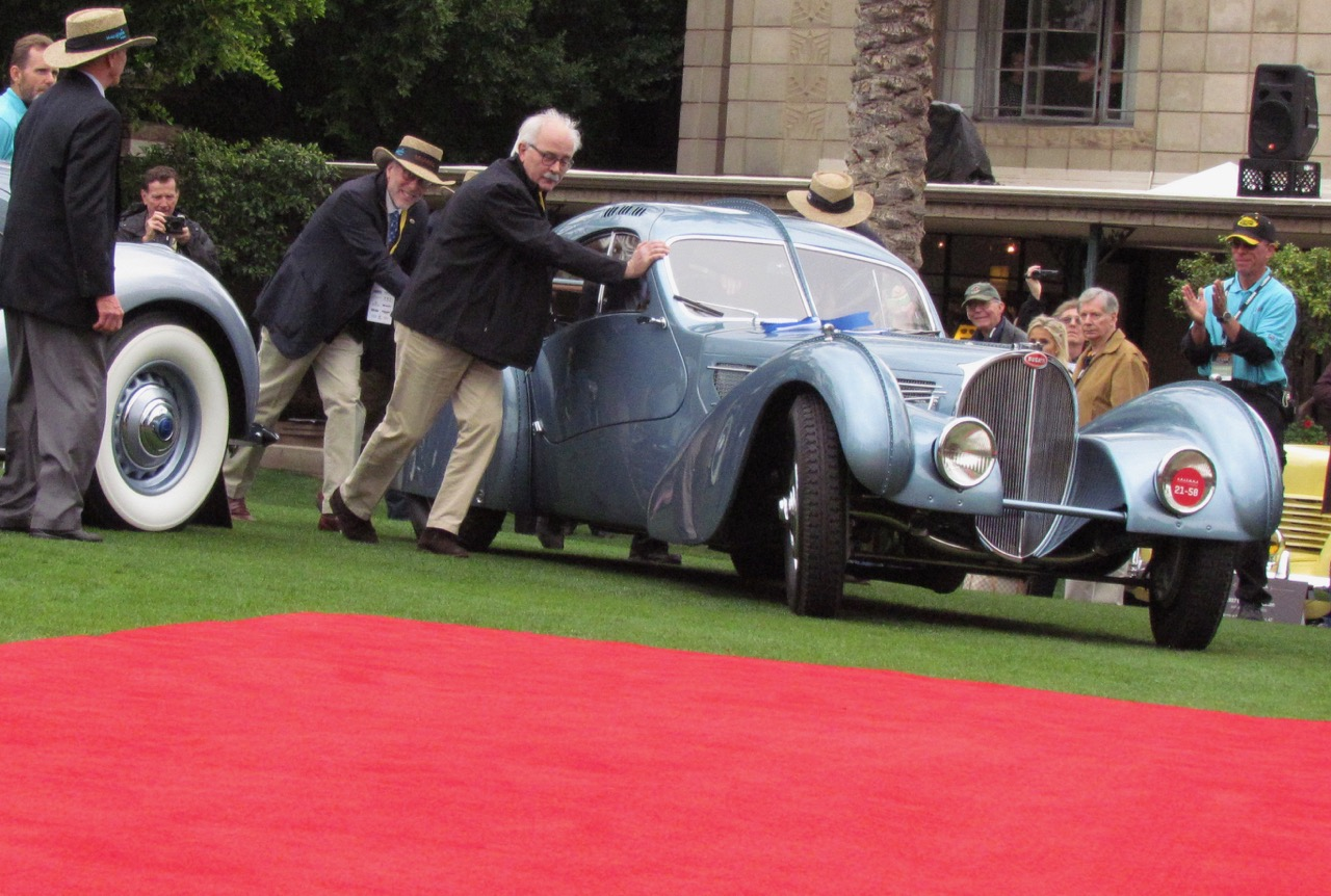Bugatti Atlantic is pushed carefully to the red carpet after its battery died | Larry Edsall photos