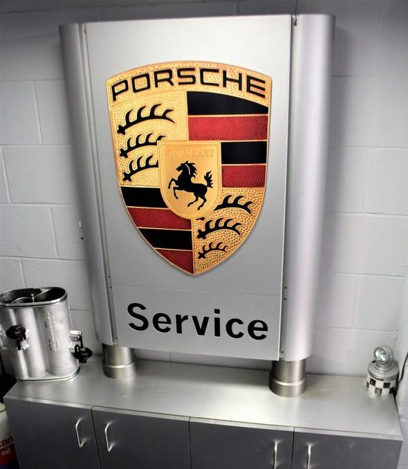 Porsche Service dealer cabinet and sign