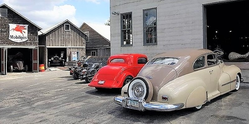 Custom cars and motorcycles belly up to the old factory housing the micro-brew pub | Badger Motorcar Company photos