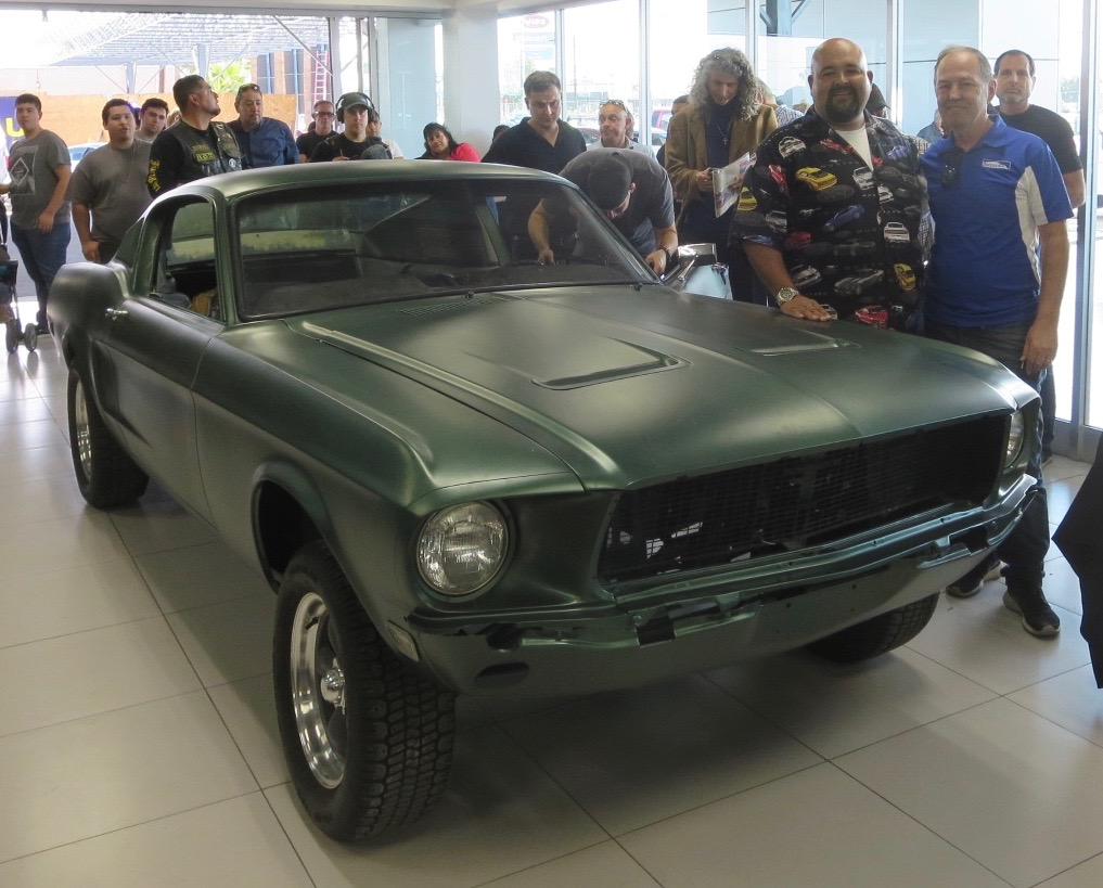 Mustang expert Kevin Marti (right) used VIN and data plate to confirm this was stunt car from movie, Bullitt. Car's co-owner Ralph Garcia Jr. (car shirt) stands next to his car | Photos courtesy Kevin Marti | Marti Report