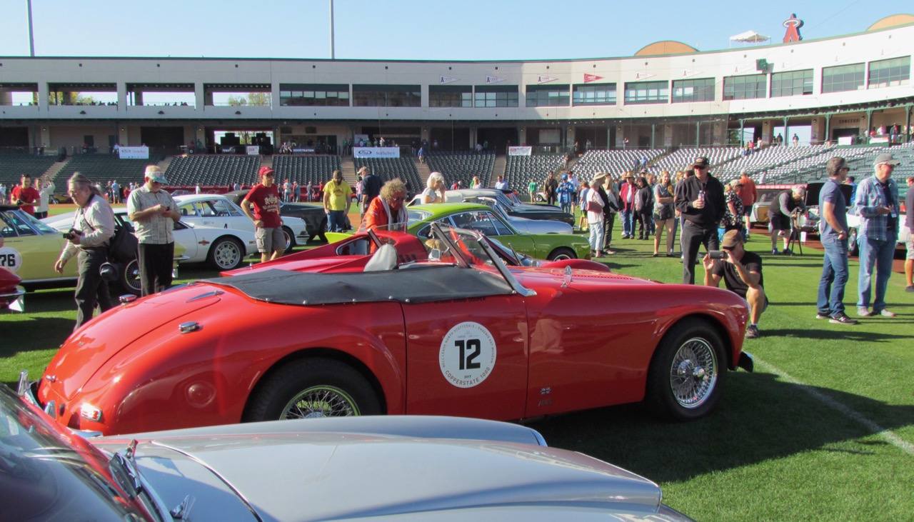 Spectators check out the Copperstate vintage sports car rally cars inside Tempe Diablo Stadium | Larry Edsall photos