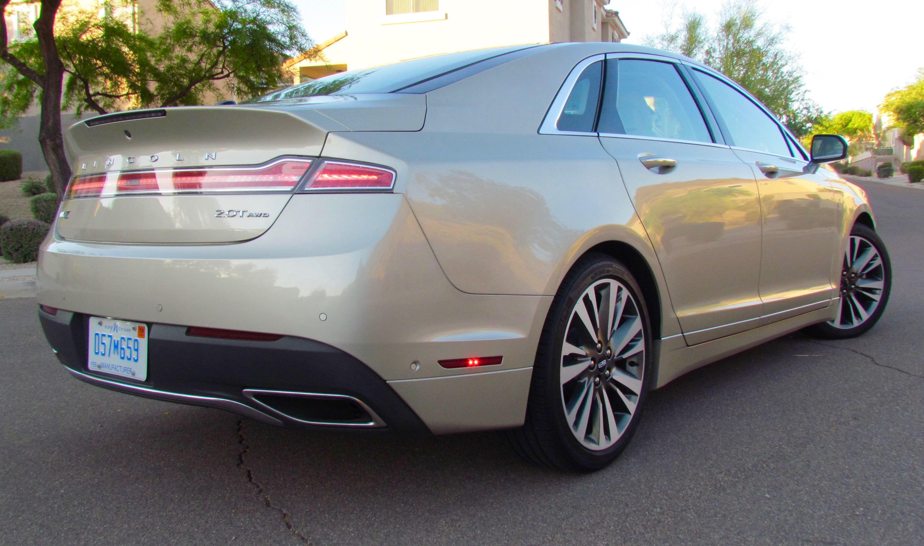 Badge tells others your luxury ride has a four-cylinder, albeit turbocharged engine