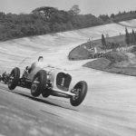 John Cobb in the 24 litre Napier-Railton taking the 'bump' on the Members' Banking 1935