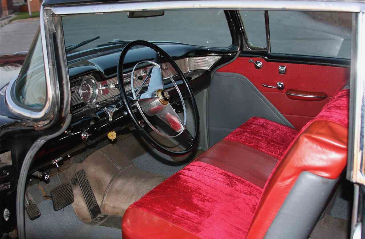 Interior is red and gray cloth