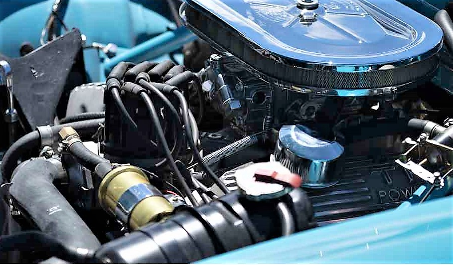 The Ford V8 is tightly nestled in the narrow engine compartment