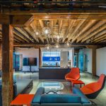 Contemporary amenities blend with preserved woodwork inside the