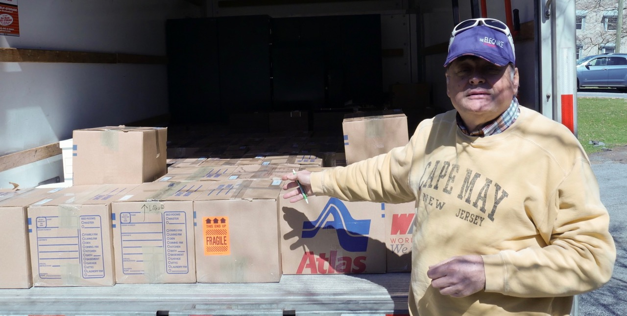 Mark Theisen delivers boxes of books | AACA library photo
