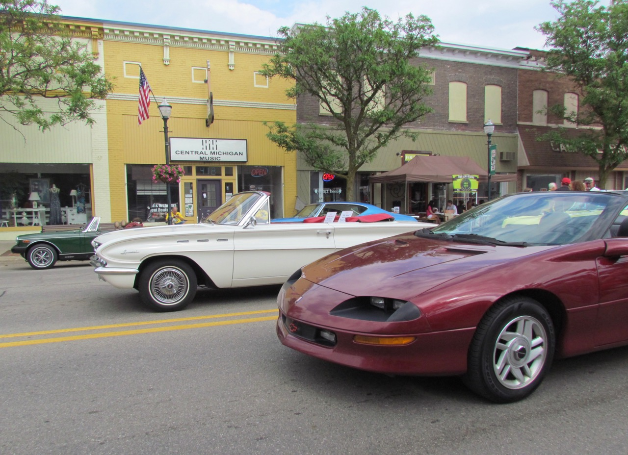 One-owner '79 MG Midget, Flint-built '62 Buick Special convertible and '95 Camaro convertible in downtown Clare, Michigan | Larry Edsall photos