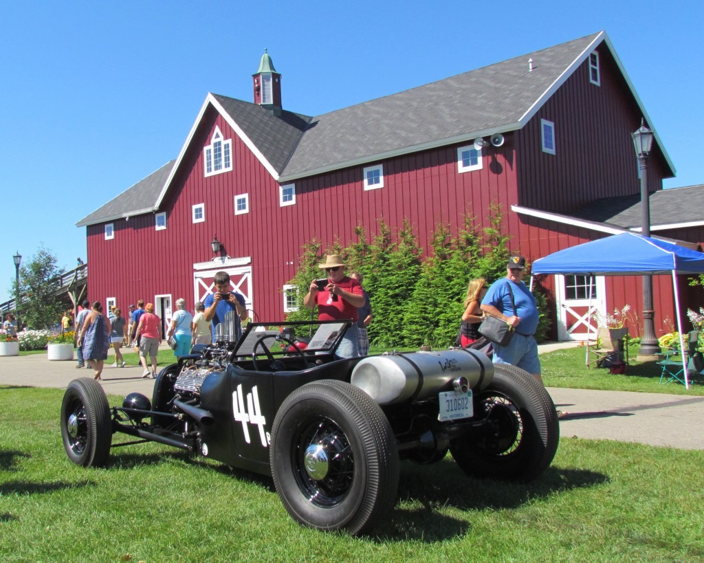 Classic cars such as this Bonneville racer amid the Gilmore's red barns | Larry Edsall photo