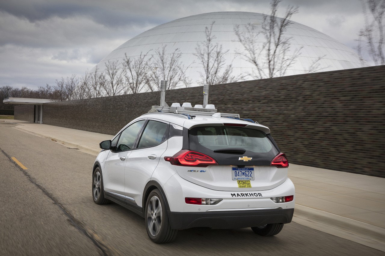 A Chevrolet Bolt drives itself past the GM Design dome | GM photo