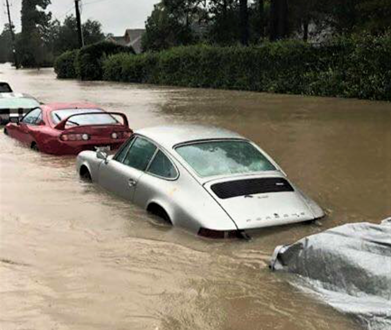 A Porsche 911 And Toyota Supra Are Hip Deep In Water In This Facebook Photo