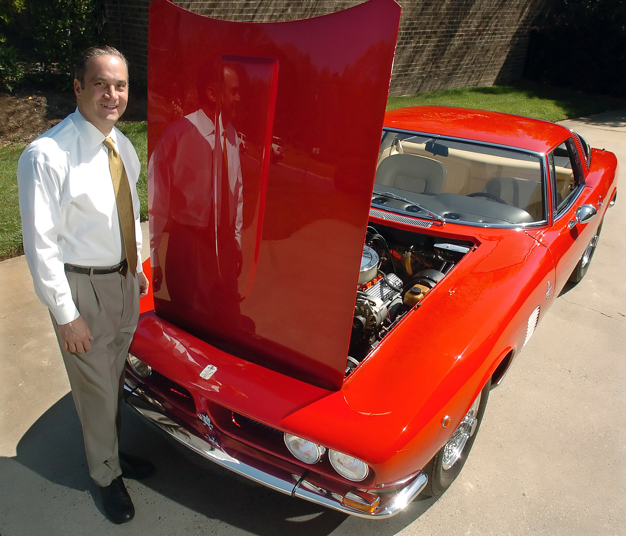 Darren Frank and his car | Diedra Laird / Charlotte Observer photover.com