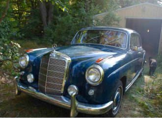 Blue Benz with red leather interior needs some TLC